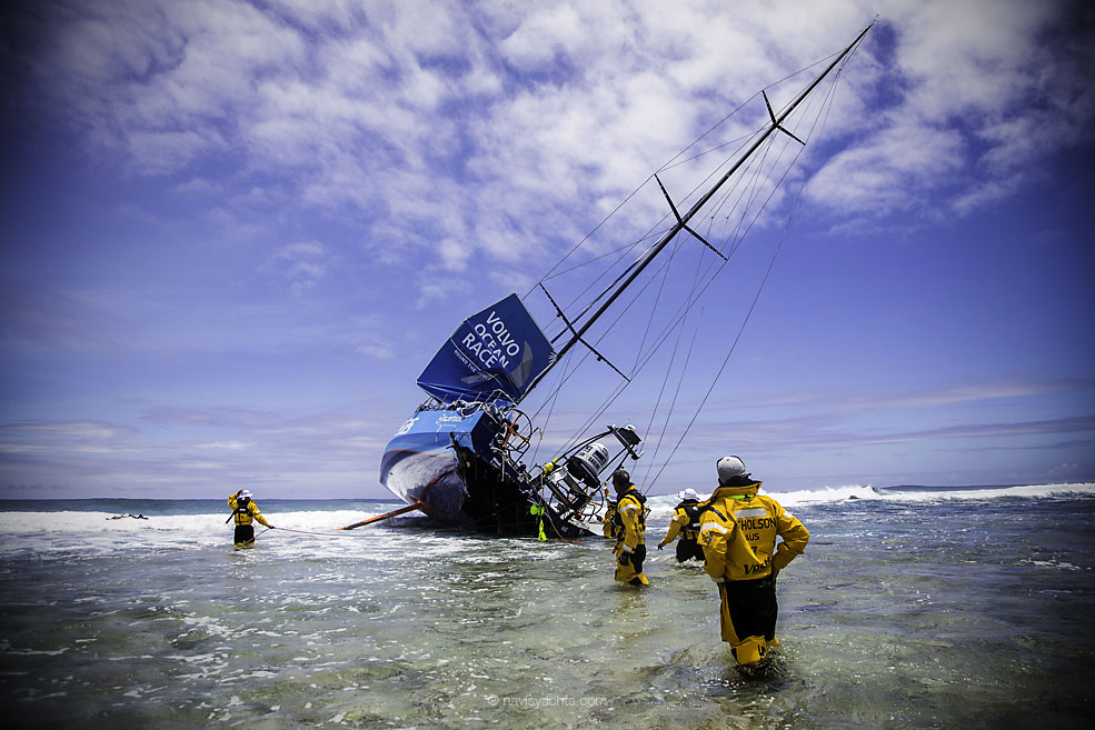 November 30, 2014. Team Vestas Wind's boat grounded on the Cargados Carajos Shoals, Mauritius, in the Indian Ocean. Fortunately, no one has been injured. In this image, the crew head back to the boat to retrieve everything they can; including ropes, diesel, Inmarsat dome and sails.