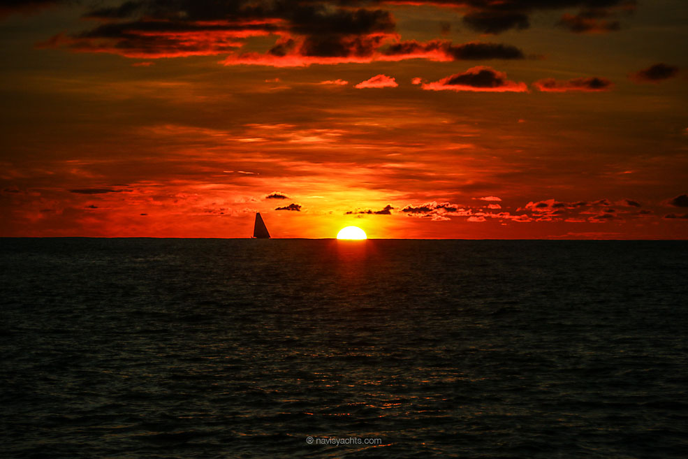 December 3, 2014. Leg 2 onboard Dongfeng Race Team. Team Brunel in the sunset less than 1 mile away.