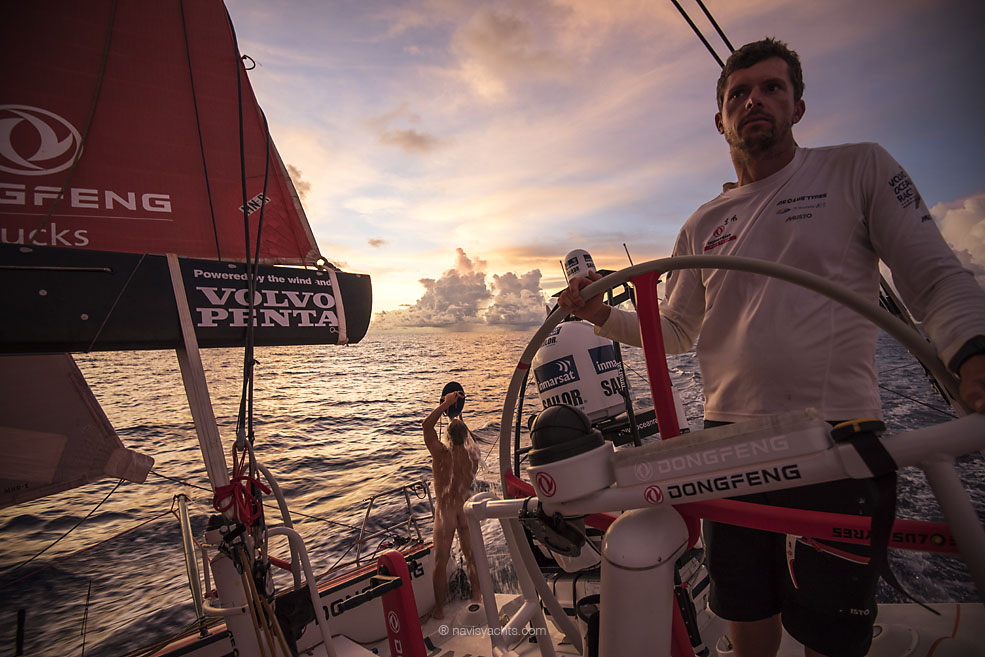 February 20, 2015. Leg 4 to Auckland onboard Dongfeng Race Team. Day 12. Kevin Escoffier takes a shower while Thomas Rouxel helms.