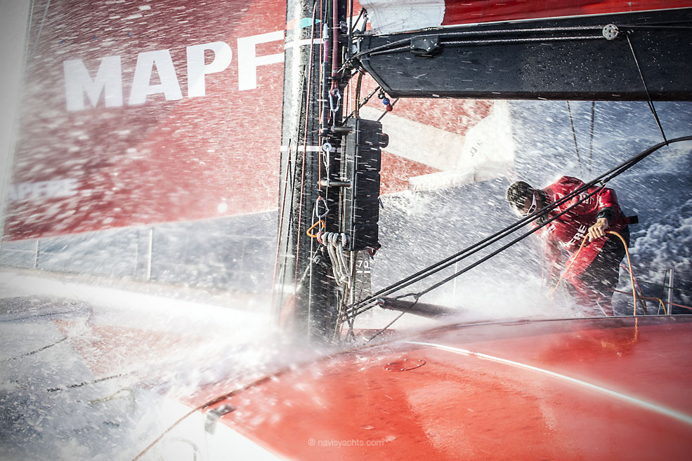 January, 2015. Leg 3 onboard MAPFRE. Carlos Hernandez fights to walk against a wave onboard as the fleet experiences stronger winds in the channel between India and Sri Lanka.